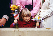 Rachel Bartow, 5, of Lorton, Virginia, patiently awaits the arrival of Princess Diana and Prince Charles at the J.C. Penney department store in Springfield, Virginia on November 11, 1985. Rachel came with a bouquet of flowers she hopes to present to the Princess.<br /> Credit: Howard L. Sachs / CNP
