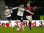 Tom Lawrence of Derby County tackled by Sam Hoskins of Northampton during the FA Cup match at the Pride Park Stadium, Derby. Picture date: 4th February 2020. Picture credit should read: Darren Staples/Sportimage