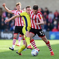 Lincoln City's Shay McCartan is fouled by Cheltenham Town's Jordan Tillson<br /> <br /> Photographer Chris Vaughan/CameraSport<br /> <br /> The EFL Sky Bet League Two - Lincoln City v Cheltenham Town - Saturday 13th April 2019 - Sincil Bank - Lincoln<br /> <br /> World Copyright &copy; 2019 CameraSport. All rights reserved. 43 Linden Ave. Countesthorpe. Leicester. England. LE8 5PG - Tel: +44 (0) 116 277 4147 - admin@camerasport.com - www.camerasport.com