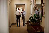 United States President Barack Obama and Vice President Joe Biden talk in a West Wing hallway at the White House in between meetings to discuss ongoing efforts in the debt limit and deficit reduction talks, Sunday, July 31, 2011. .Mandatory Credit: Pete Souza - White House via CNP