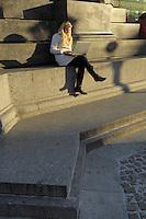 Poland, Krakow, Woman with laptop computer, Rynek Glowny, Grand Square