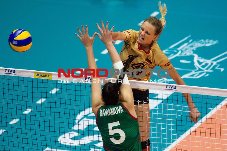 05.10.2014, Pala Trieste, Triest<br /> Volleyball, FIVB Volleyball Women`s World Championship 2014, 2. Runde, Deutschland (GER) vs. Aserbaidschan (AZE)<br /> <br /> Block Odina Bayramova (Aliyeva) (#5 AZE) - Angriff Margareta Kozuch (#14 GER)<br /> <br />   Foto &copy; nordphoto / Kurth