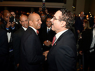Washington, DC - January 2, 2015: Former Mayors Anthony Williams (l) and Vincent C. gray (r) share a laugh at the conclusion of the 2015 inauguration ceremony held at the Washington Convention Center, January 2, 2015.   (Photo by Don Baxter/Media Images International)