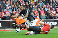 Burnley's Aaron Lennon is tackled by Southampton's Wesley Hoedt<br /> <br /> Photographer Kevin Barnes/CameraSport<br /> <br /> The Premier League - Southampton v Burnley - Sunday August 12th 2018 - St Mary's Stadium - Southampton<br /> <br /> World Copyright &copy; 2018 CameraSport. All rights reserved. 43 Linden Ave. Countesthorpe. Leicester. England. LE8 5PG - Tel: +44 (0) 116 277 4147 - admin@camerasport.com - www.camerasport.com