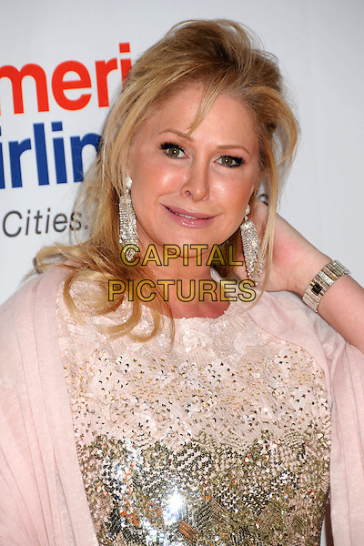 KATHY HILTON.18th Annual Race To Erase MS held at the Hyatt Regency Century Plaza Hotel, Century City, California, USA..April 29th, 2011.headshot portrait white cream gold sequins sequined hand earrings.CAP/ADM/BP.©Byron Purvis/AdMedia/Capital Pictures.