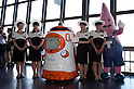 "August 01 2012, Tokyo, Japan - The new staff swearing-in ceremony at Tokyo Tower. Tokyo Tower implemented the new robot guide which name is ""Tawabo"", the first indoor robot guide in Japan. It can speak Japanese, English, Chinese and Korean, it weights 200kg and it is 160cm tall."