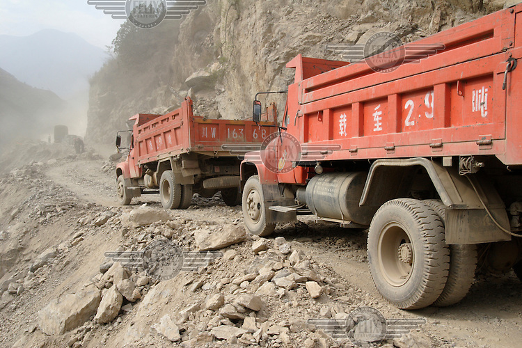 The construction site for a new road leading to a massive new hydro-electric dam complex which will displace thousands of local Tibetans in Western Sichuan, originally part of Eastern Tibet.