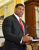 Former NFL running back and and mixed martial artist Herschel Walker makes remarks at a press conference to discuss the observational study on the brain health of active and retired professional fighters on Capitol Hill in Washington, DC on Tuesday, April 26, 2016.  The study, led by researchers from the Cleveland Clinic, is  designed to better identify, prevent and treat Chronic Traumatic Encephalopathy (CTE.)<br /> Credit: Ron Sachs / CNP