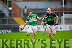 Damien O'Sullivan Legion  gets in his shot under pressure from Dylan Mehigan Nemo Rangers during the AIB Munster club SFC clash in Pairc Uí Rinn on Sunday