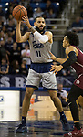 Nevada forward Cody Martin (11) looks to pass the ball against Little Rock in the second half of an NCAA college basketball game in Reno, Nev., Friday, Nov. 16, 2018. (AP Photo/Tom R. Smedes)