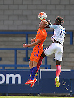 Dani De Wit (Ajax) of Holland & Trevoh Chalobah (Chelsea) of England U19 in the air during the International match between England U19 and Netherlands U19 at New Bucks Head, Telford, England on 1 September 2016. Photo by Andy Rowland.