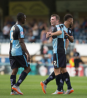 Garry Thompson (centre) of Wycombe Wanderers with goal scorers Anthony Stewart (left) of Wycombe Wanderers and Aaron Amadi Holloway of Wycombe Wanderers during the Sky Bet League 2 match between Wycombe Wanderers and York City at Adams Park, High Wycombe, England on 8 August 2015. Photo by Andy Rowland.