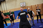 BERLIN 12.2016. GWF (German Wrestling Federation) during training. man in center: Andre Trucker<br /> <br /> STORY: German Wrestler RAMBO MICHEL BRAUN alias EL COMANDANTE RAMBO during training at GWF Wrestling School in Berlin Neukölln.<br /><br />Other trainers are: Crazy Sexy mike (Hussein Chaer, man with headband) and Ahmed Chaer (man with beard) (Photo by Gregor Zielke)