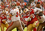 San Francisco 49ers defensive end Chidi Ahanotu (72) rushes Tampa Bay Buccaneers quarterback Brad Johnson (14) on Sunday, October 19, 2003, in San Francisco, California. The 49ers defeated the Buccaneers 24-7.