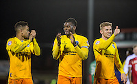 Aaron Pierre (centre) of Wycombe Wanderers talks to goalscorer Paris Cowan-Hall of Wycombe Wanderers as Jason McCarthy of Wycombe Wanderers gives a thumb up to the supporters at full time during the Sky Bet League 2 match between Dagenham and Redbridge and Wycombe Wanderers at the London Borough of Barking and Dagenham Stadium, London, England on 9 February 2016. Photo by Andy Rowland.