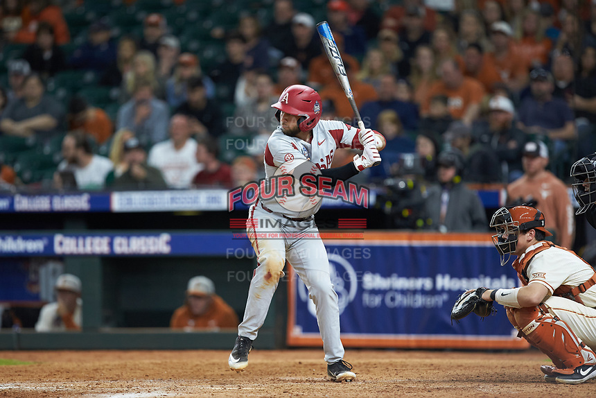 Casey Opitz (12) of the Arkansas Razorbacks at bat against the Texas Longhorns in game six of the 2020 Shriners Hospitals for Children College Classic at Minute Maid Park on February 28, 2020 in Houston, Texas. The Longhorns defeated the Razorbacks 8-7. (Brian Westerholt/Four Seam Images)