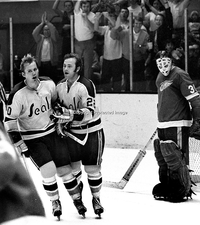 California Golden Seals score goal, Stan Gilbertson and Joey Johnston celebrate in front of Detroit Redwing goalie . (photo 1971/Ron Riesterer)