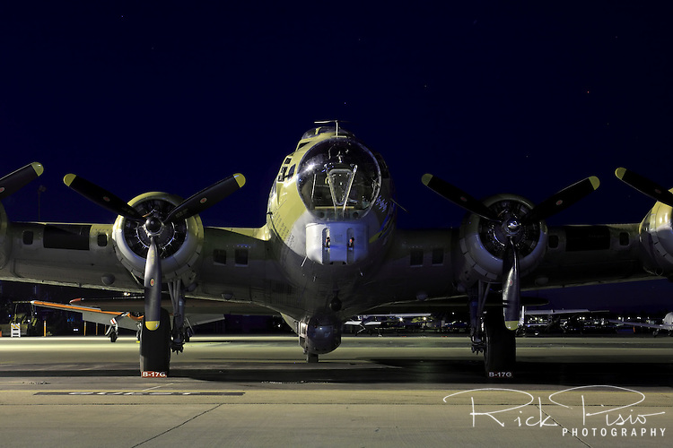 """Boeing built B-17 Flying Fortress """"Nine-O-Nine"""" operated by the Collings Foundation sits on the ramp at Livermore Airport in Livermore, California, during its annual tour in May 2009. The Collings Foundation B-17 was named """"Nine-O-Nine"""" in honor of a 91st Bomb Group, 323rd Squadron plane of the same name which completed 140 missions without an abort or loss of a crewman. The original """"Nine-O-Nine"""" was assigned to combat on February 25, 1944. By April 1945, she had made eighteen trips to Berlin, dropped 562,000 pounds of bombs, and flown 1,129 hours. She had twenty-one engine changes, four wing panel changes, fifteen main gas tank changes, and 18 Tokyo tank changes (long-range fuel tanks). She also suffered from considerable flak damage."""