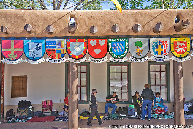 A traditional part of the festivities at the annual Santa Fe Fiesta, the Sunday Procession starts at the Palace of the Governors and moves around the plaza and up to the St. Francis Cathedral. During Fiesta, Spanish Coats of Arms are hung on the Palace of the Governors.