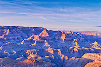 Sunset over the Grand Canyon is a wonderous site to see.  The canyons are such a geologic wonder with all the different colors of rock which have been exposed through erosion and other processes to create these wonder mountains where the colorado river runs through constantly changing the river banks as the waters deposit sand and silt to other areas of the canyons and as the mountains erode they deposit some of there good down below.