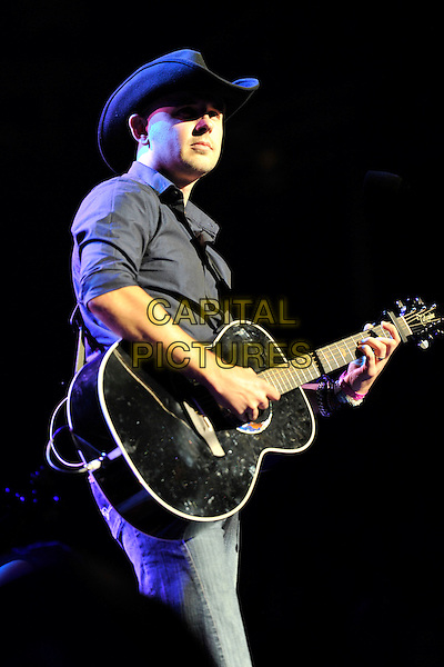 ELLIOTT FRISBY.The Beatles Philharmonic Tribute at the Royal Albert Hall, London, England..October 28th, 2010.stage concert live gig performance music half length black stetson cowboy hat guitar shirt.CAP/MAR.© Martin Harris/Capital Pictures.