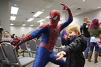NWA Democrat-Gazette/DAVID GOTTSCHALK  Sunnie (cq) Grimste, 6, poses with the character Spiderman Friday, January 11, 2019, during the annual Fayetteville Fraternal Order of Police Family Fun Night at the Chancellor Hotel in Fayetteville. Entertainment included magic shows by Joey Williams and Mike Bliss, appearances by characters Spiderman and Ariel, face painting,  balloon animals and other activities. Funds raised from the event go to support the Shop with a Cop program, scholarships, youth activities and the fishing derby.