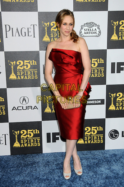 VERA FARMIGA.25th Annual Film Independent Spirit Awards - Arrivals held at the Nokia Event Deck at L.A. Live, Los Angeles, California, USA..March 5th, 2010.full length red strapless silk satin dress beige clutch bag .CAP/ADM/BP.©Byron Purvis/AdMedia/Capital Pictures.