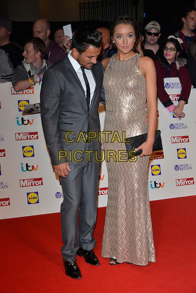 Peter Andre and Emily MacDonagh<br /> The Daily Mirror's Pride of Britain Awards arrivals at the Grosvenor House Hotel, London, England.<br /> 7th October 2013<br /> full length dress silver gold sleeveless grey gray suit pregnant couple black clutch bag looking down <br /> CAP/PL<br /> &copy;Phil Loftus/Capital Pictures