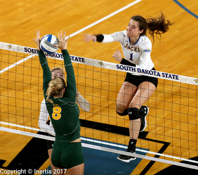 BROOKINGS, SD - SEPTEMBER 24: Sierra Peterson #1 from South Dakota State tries to get the ball past Bella Lien #8 from North Dakota State during their match Sunday evening at Frost Arena in Brookings. (Photo by Dave Eggen/Inertia)