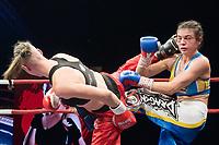 Renata Rakoczi (L) of Hungary and Antonina Osetska (R) of Ukraine fight during the WAKO  women's kick-boxing 55kg World Championship Final in Budapest, Hungary on Nov. 16, 2019. ATTILA VOLGYI