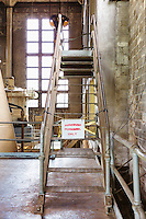 Antique Factory with Metal Stairway with Authorized Personnel Only Sign, Seattle, WA, Georgetown Steam Plant, a National Historic Landmark in Seattle, WA USA