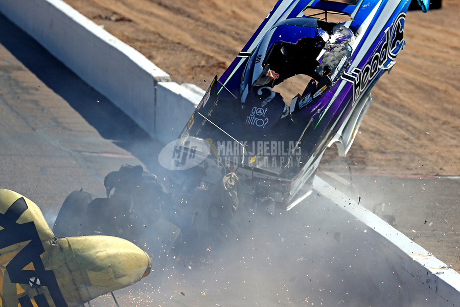 Feb 25, 2018; Chandler, AZ, USA; NHRA funny car driver John Force crashes with Jonnie Lindberg during the Arizona Nationals at Wild Horse Pass Motorsports Park. Mandatory Credit: Mark J. Rebilas-USA TODAY Sports