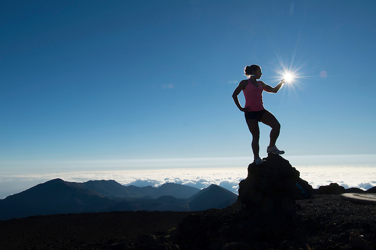 Heather Moon captures the sun from atop Mount Haleakala in Haleakala National Park on the island of Maui, Hawaii.