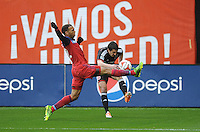 Washington, D.C.- March 29, 2014. Lewis Neal (24) of D.C. United goes against Matt Watson of the Chicago Fire.  The Chicago Fire tied D.C. United 2-2 during a Major League Soccer Match for the 2014 season at RFK Stadium.