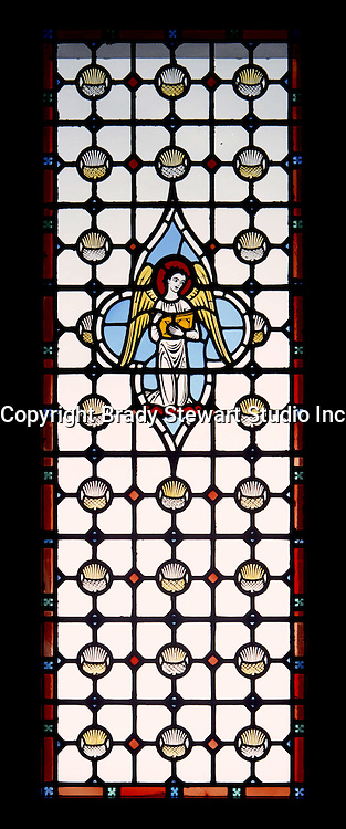 East Liberty section of Pittsburgh PA:  East Liberty Presbyterian Church; windows between the Narthex and Nave - 1977. This image is included in the book; The Art and Architecture of the East Liberty Presbyterian Church.  This window was created in the studios of Reynolds, Francis, & Rohnstock.  The images are of angels holding instruments of praise and copy of the Scriptures.