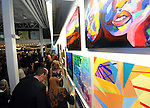 "Guests look at the art on the wall during ""The Greatest Party on Earth"", benefiting Artists For Humanity, Saturday April 25, 2015, at the EpiCenter in South Boston. Boston Herald Photo by Jim Michaud"