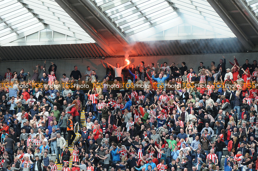 Sunderland fans set off flares after Stéphane Sessegnon's opener - Newcastle United vs Sunderland - Barclays Premier League Football at St James Park, Newcastle upon Tyne - 14/04/13 - MANDATORY CREDIT: Steven White/TGSPHOTO - Self billing applies where appropriate - 0845 094 6026 - contact@tgsphoto.co.uk - NO UNPAID USE