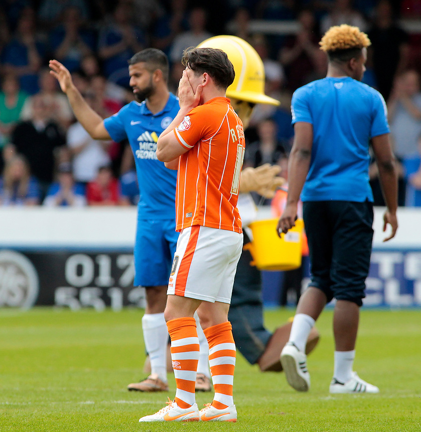 Blackpool's Jack Redshaw shows his dejection at the final whistle as his side are relegated<br /> <br /> Photographer David Shipman/CameraSport<br /> <br /> Football - The Football League Sky Bet League One - Peterborough United v Blackpool  - Sunday 8th May 2016 - ABAX Stadium - London Road   <br /> <br /> &copy; CameraSport - 43 Linden Ave. Countesthorpe. Leicester. England. LE8 5PG - Tel: +44 (0) 116 277 4147 - admin@camerasport.com - www.camerasport.com