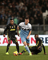 Football, Serie A: S.S. Lazio - Juventus, Olympic stadium, Rome, January 27, 2019. <br /> Lazio's Sergej Milinkovic-Savic (c) in action with Juventus' Alex Sandro (l) and Blaise Matuidi (r) during the Italian Serie A football match between S.S. Lazio and Juventus at Rome's Olympic stadium, Rome on January 27, 2019.<br /> UPDATE IMAGES PRESS/Isabella Bonotto