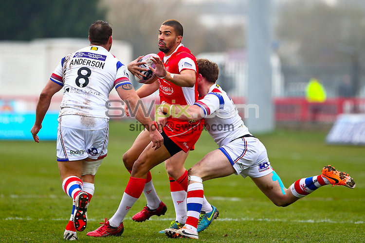 Picture by Alex Whitehead/SWpix.com - 30/03/2014 - Rugby League - First Utility Super League - Hull Kingston Rovers v Wakefield Trinity Wildcats - KC Lightstream Stadium, Hull, England - Hull KR's Omari Caro is tackled by Wakefield's Danny Kirmond.