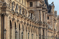 Facade of the Cour Napoleon at the Musee du Louvre, Paris, France, with the Hommes Illustres, a series of 86 statues of famous men placed above the colonnade of the courtyard 1853-57 under the architects Louis Visconti and Hector Lefuel. These wings were built during the Second Empire under Napoleon III in the 1850s in Neo-Baroque style, linking the original Louvre building with the Palais des Tuileries, which burnt down in 1871 and was razed in 1873. Picture by Manuel Cohen