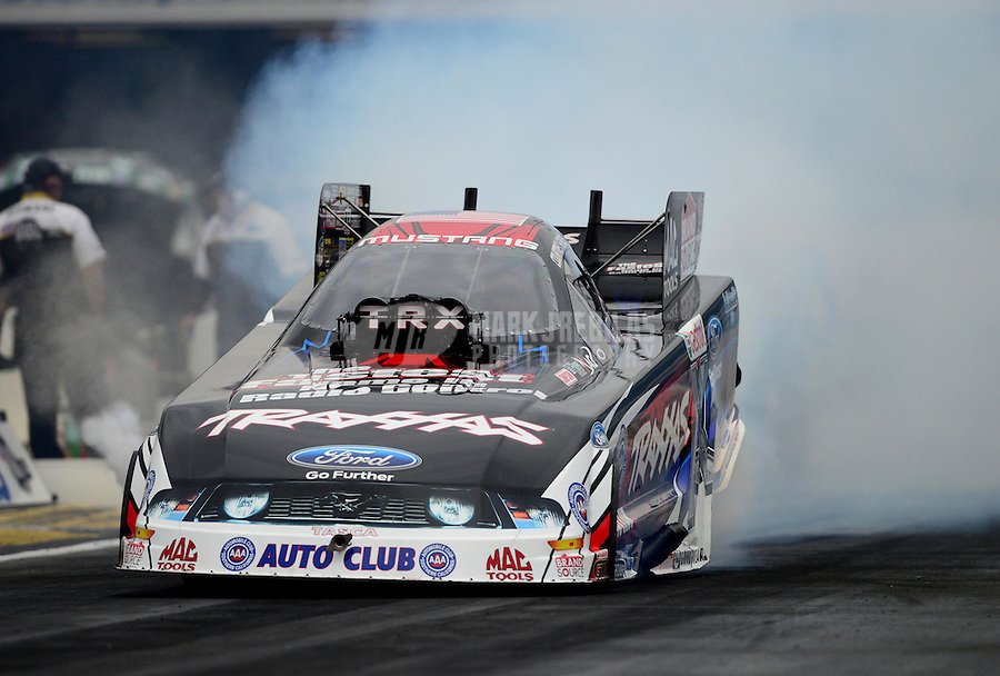 Nov. 8, 2012; Pomona, CA, USA: NHRA funny car driver Courtney Force during qualifying for the Auto Club Finals at at Auto Club Raceway at Pomona. Mandatory Credit: Mark J. Rebilas-