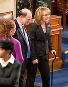 Former United States Representative Gabby Giffords (Democrat of Arizona), right, walks onto the floor with US Representative Brad Sherman (Democrat of California), center, as US Representative  Elizabeth Esty (Democrat of Connecticut), left, looks on prior to US President Barack Obama delivering his final State of the Union Address in the US House Chamber in the US Capitol on Tuesday, January 12, 2016.<br /> Credit: Ron Sachs / CNP