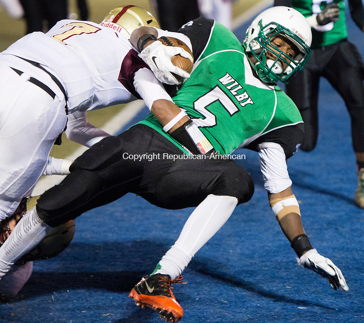 WATERBURY, CT - 25 November 2015-112515EC06--  Wilby's Darrien Bell scores a touchdown as Sacred Heart's Rashaun Ivester attempts a tackle Friday night. Erin Covey Republican-American.