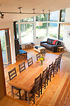 An open floor plan, cathedral ceiling, and floor-to-ceiling windows create a sense of space in a small contemporary home. This image is available through an alternate architectural stock image agency, Collinstock located here: http://www.collinstock.com