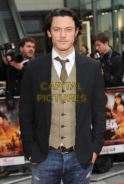 "LUKE EVANS.The World Premiere of ""Prince Of Persia - Sands Of Time"", The Vue Westfield, London, England..9th May 2010.half length waistcoat jacket black white brown stubble facial hair . CAP/BEL.©Tom Belcher/Capital Pictures."