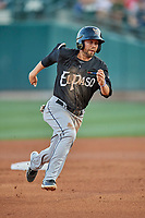 Peter Van Gansen (12) of the El Paso Chihuahuas hustles towards third base against the Salt Lake Bees at Smith's Ballpark on August 17, 2019 in Salt Lake City, Utah. The Bees defeated the Chihuahuas 5-4. (Stephen Smith/Four Seam Images)