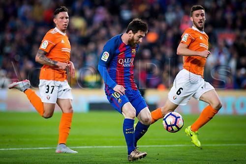 April 26th 2017, Nou Camp, Barcelona, Spain, La Liga football, FC Barcelona versus CA Osasuna; Leo Messi of Barcelona dribbles the Osasuna defense