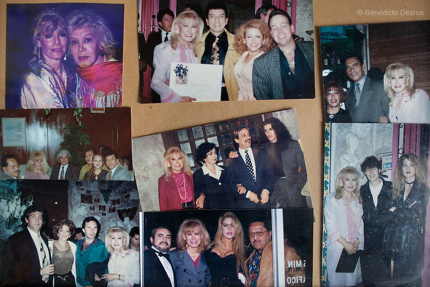 """September 29, 2015 - Mexico City, Mexico - Old photographsof Samantha, at age 40, with close friends and Mexican television personalities at thenightclub """"La Cucaracha"""" in Mexico City. Samantha Flores is an 83-year-old transgender woman from Veracruz, Mexico. She is a prominent social activist for LGBTQI rights and is the founder of the non-profit organization """"Laetus Vitae"""", a day shelter for elderly gay people in Mexico City. Senior citizens in general are many times prone to neglect and abandonment by their families, leaving them all but invisible. Their plight can be even worse if they are homosexual. Photo credit: Bénédicte Desrus"""