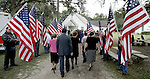 Guests arrive at the Chaires United Methodist Church in the Chaires community near Tallahassee, Florida for the funeral service of U.S. Marine Lance Cpl. Daniel B. Chaires Nov. 2, 2006. Guests walked through a salute of American flags held by the Patriot Guard Riders.